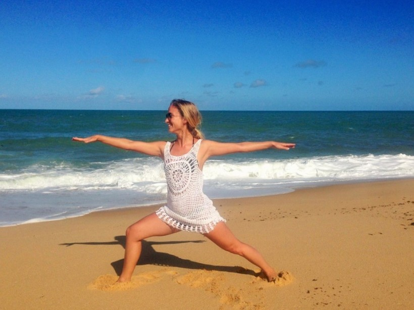 Nina Sadlowsky practising yoga on the beach