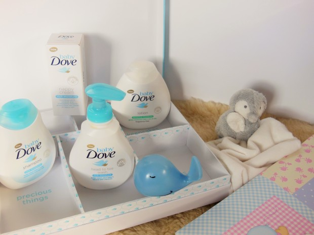 Baby Dove range with cuddly toy penguin