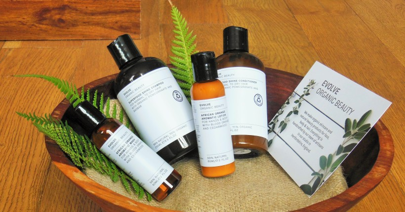 Evolve Organic Beauty products in a wooden bowl