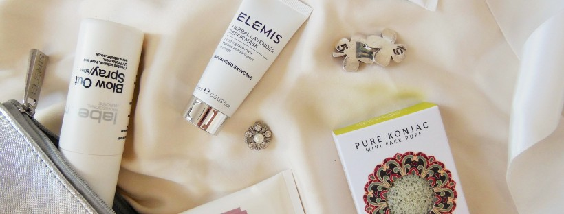 Beauty flatlay featuring skincare products on silk background