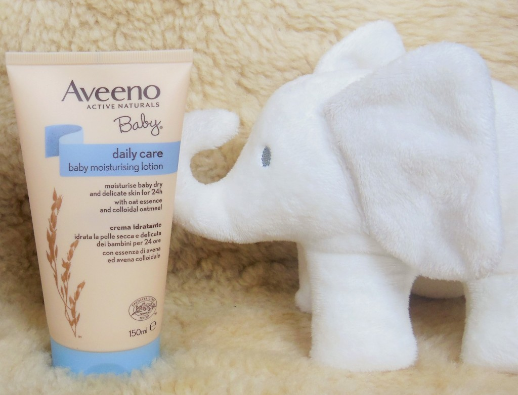 Aveeno Baby Daily Care Moisturising Lotion with white elephant cuddly toy