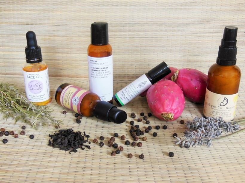 British skincare products with natural ingredients on rattan mat