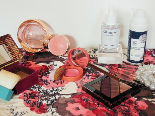 Six beauty products from around the world on a Japanese print floral back