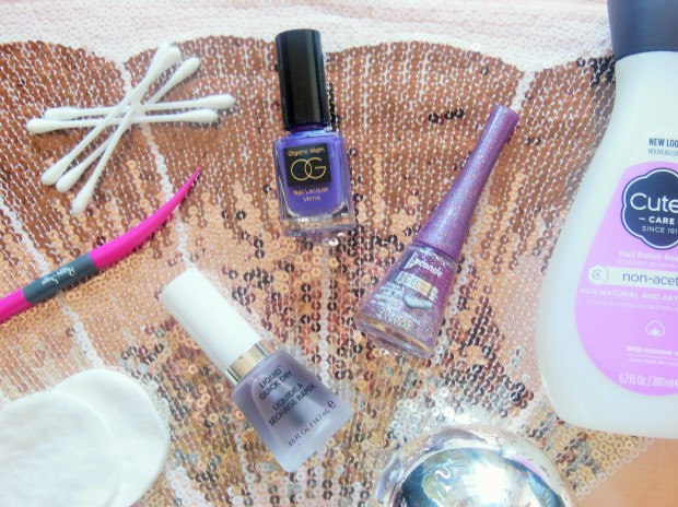 Nail polish bottles and accessories on a sequin background
