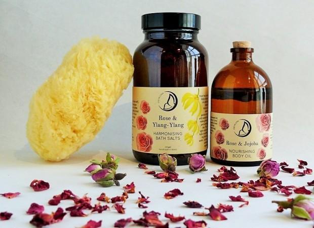 Freyaluna Rose Ylang-Ylang Bath Salts and Rose Jojoba Body Oil with sea sponge and rose petals