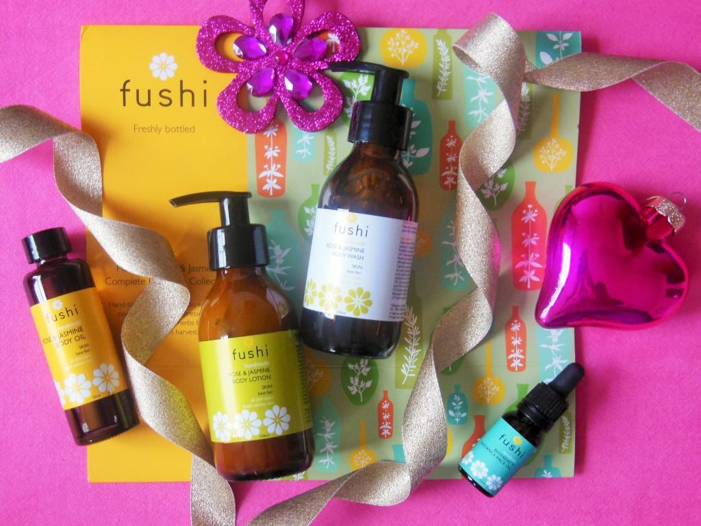 Fushi Rose and Jasmine Gift Set flatlay with Christmas decorations