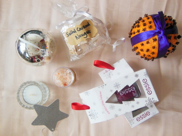 Homemade beauty hamper including nail polish, bath salts, scented candle, cloved orange and nougat