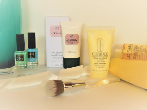 Beauty product range featuring nail polish, hand cream and hair oil
