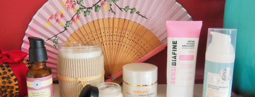 Face creams on a shelf with pink fan