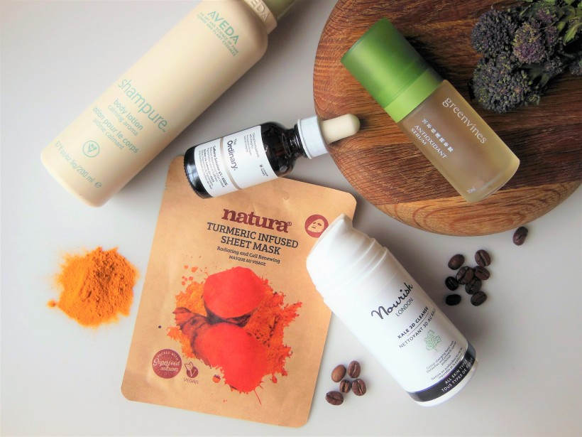 Flatlay of skincare products containing food ingredients