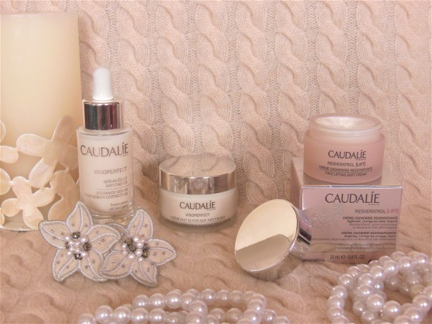 Caudalie skincare products on cashmere background
