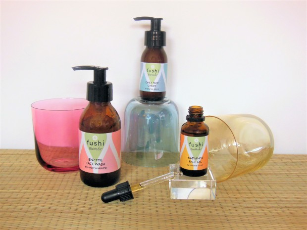 Three natural skincare products with coloured glasses