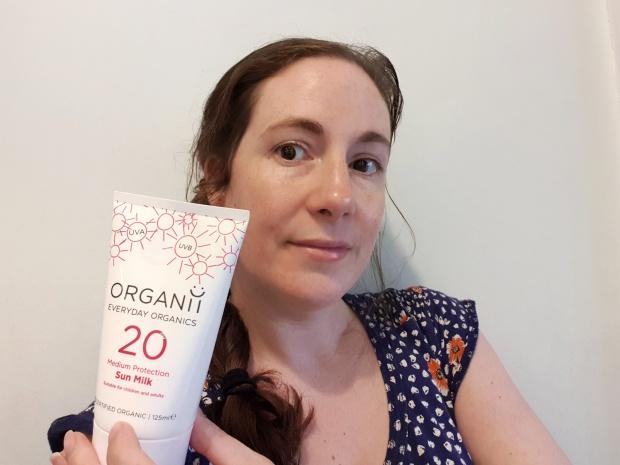 Emma holding Organii Sun Milk