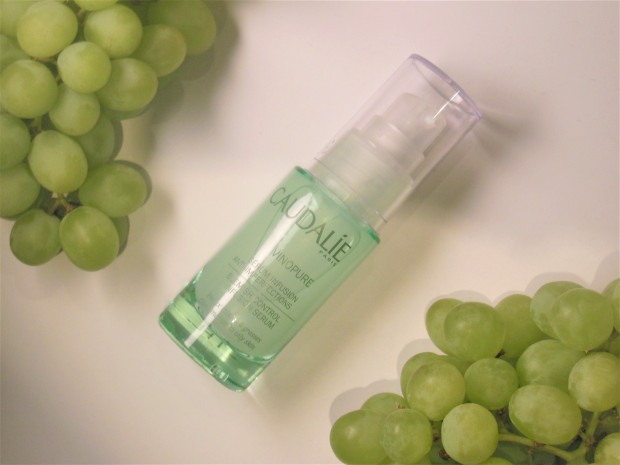 Caudalie Vinopure skincare flatlay with green grapes