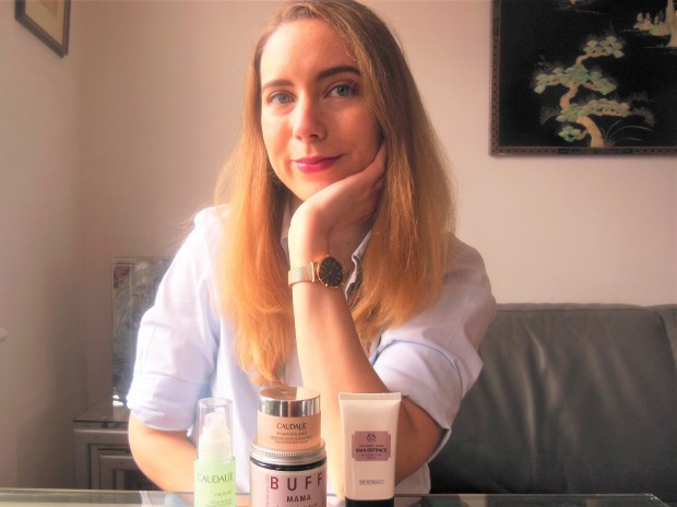 Portrait with skincare products on table