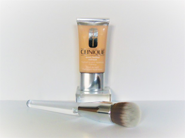 Clinique Even Better Refresh Foundation and Buff Brush on white background