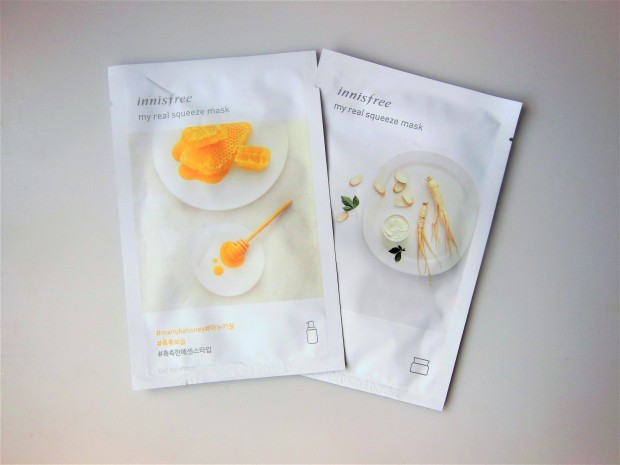 Two sheet masks on a grey background