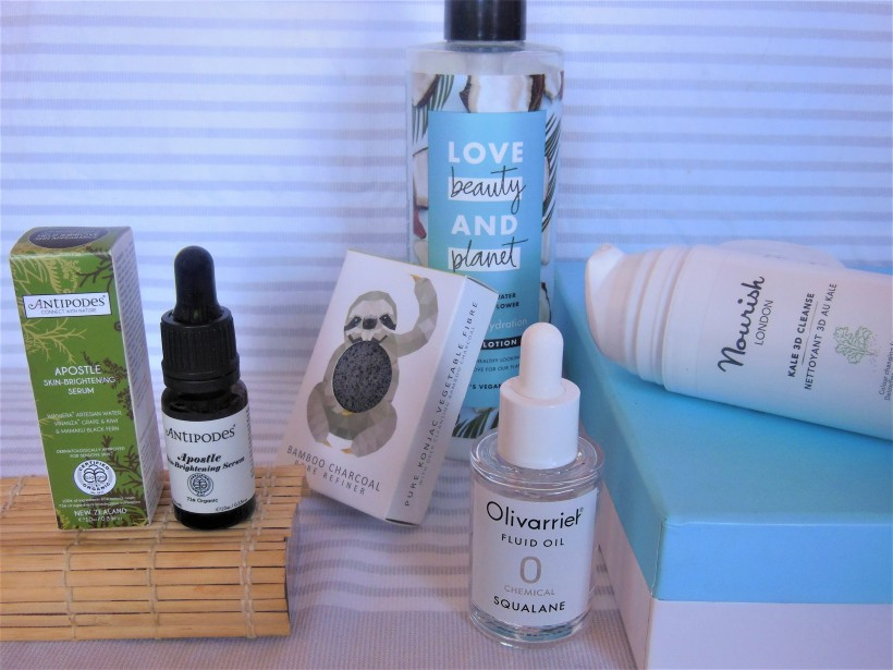 Vegan certified skincare products on stripy background