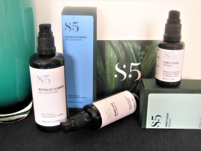 Three black pump dispensers from the S5 skincare range
