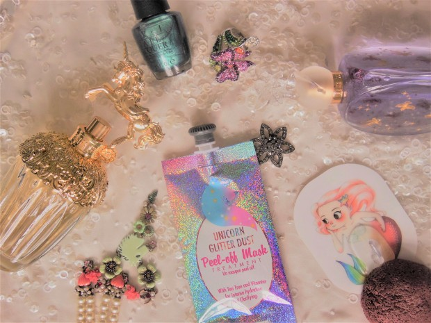 Beauty products inspired by mythical creatures flatlay