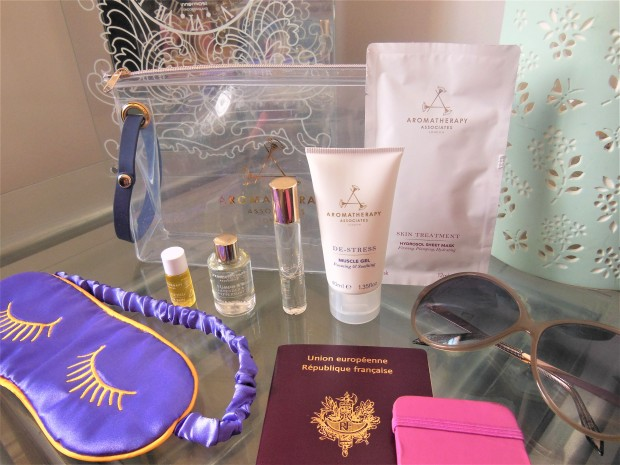 Travel essentials including toiletries, eye mask, sunglasses and passport