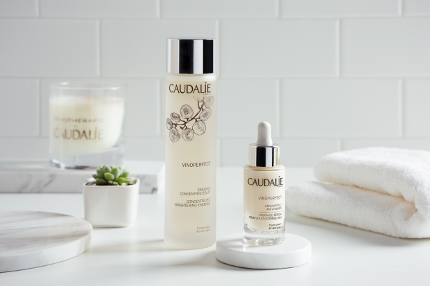 Caudalie skincare products in white bathroom