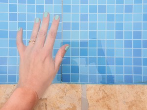 Aqua manicure hand in swimming pool