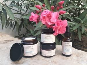 Aurelia Probiotics Skincare products with pink flower