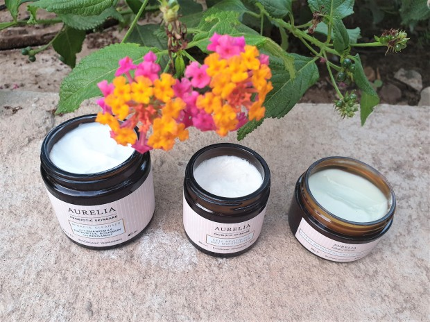 Aurelia Probiotic Skincare open jars with orange flower