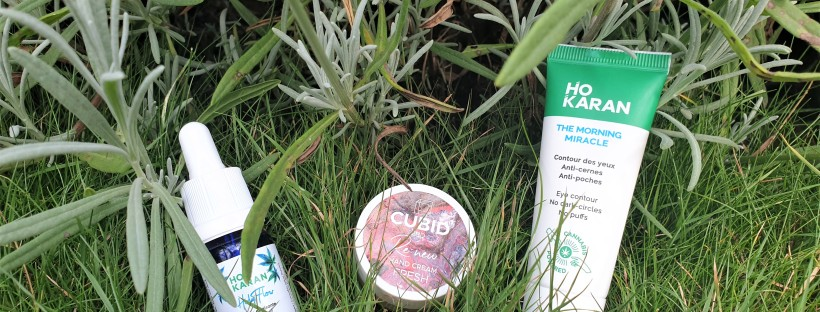 CBD oil skincare products on grass