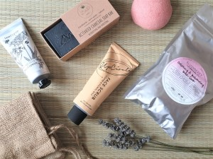 Natural skincare products on a rattan mat