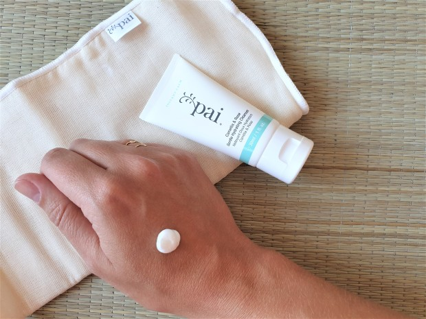Pai gentle hydrating cleanser on hand with cloth