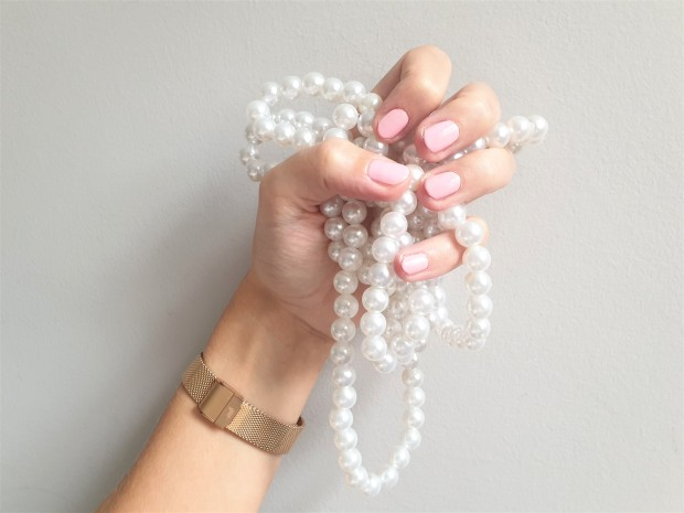 Pale Pink Manicure on hand holding pearls