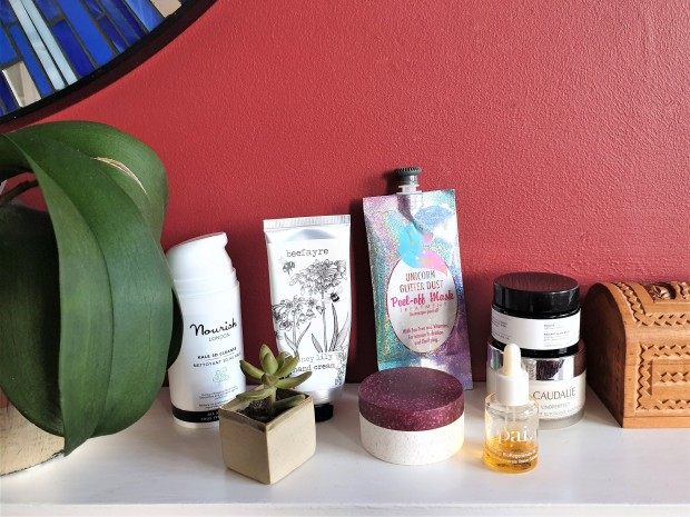 Top skincare products on a white shelf with red background