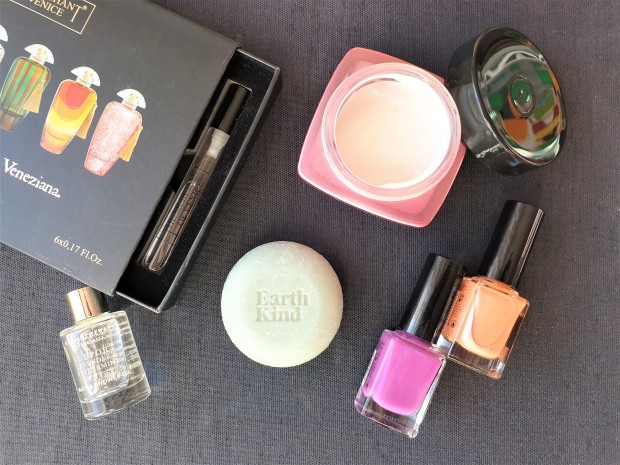 Beauty products flatlay with fragrance, bath essence, cream, soap and nail polish