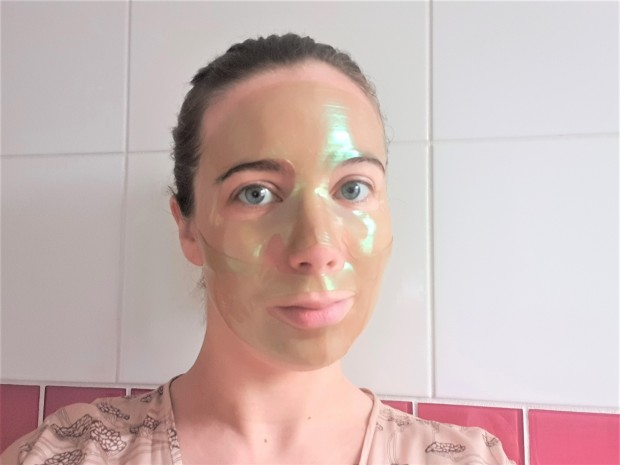 blogger wearing sheet mask