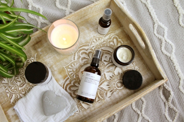 Evolve Organic Beauty products on wooden tray
